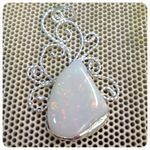 Silver pendant set with opal